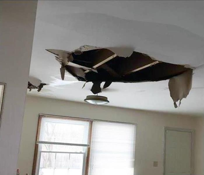 a ceiling caving in after a storm hit