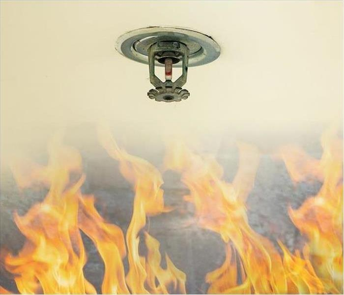 Flames approaching sprinkler head on fire suppression system